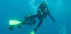 Duiken in de baai van Tolo